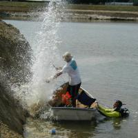 Using a Betsy Seisgun as a Seismic Source for an Underwater Refraction Survey (Florida)